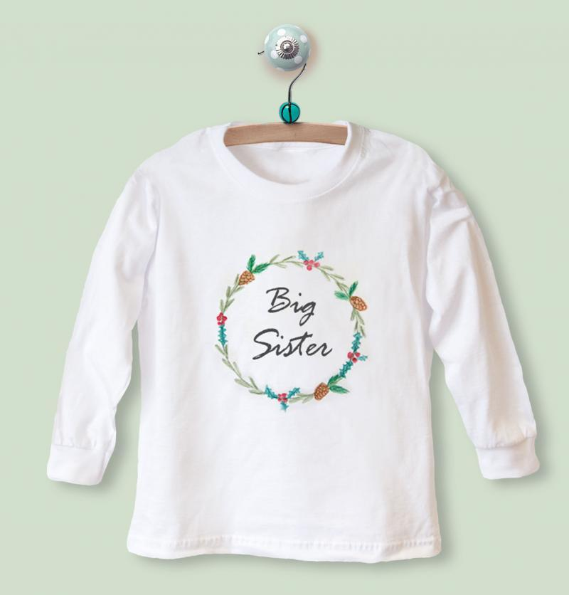 big sister top with wreath